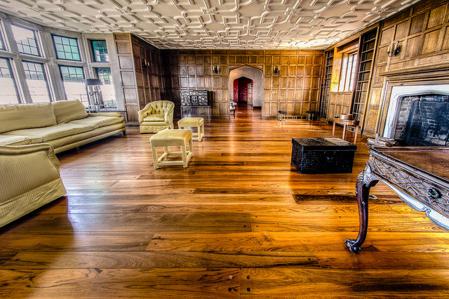 a large room renovated with hardwood floor