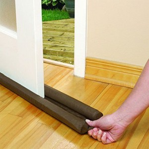 woman installing a twin draft guard to an exterior door