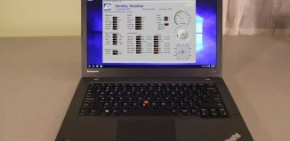 laptop computer running weather station software
